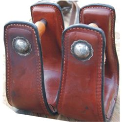 leather covered stirrups with silver bolts