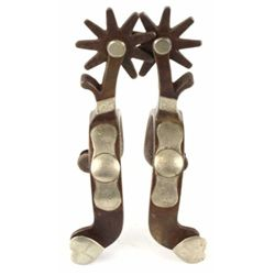 Pair Crockett stamped single mount spurs peanut design, marked on outside heal band.
