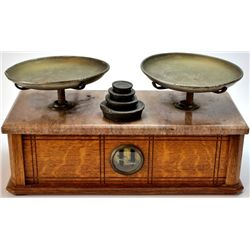 Terrific 19th C. gold scale oak cased, marble top with original brass pans intact and includes weigh