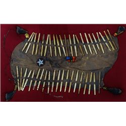 "Bone and leather breast plate, 21"" long decorated with deer hoofs and old trade beads and added bead"