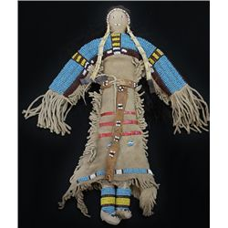 Northern Plains beaded buckskin doll with fringe dress and incorporated moccasins, horizontal quill