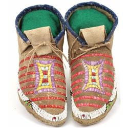 C. 1900 Plains beaded and quill moccasins in very good original condition with hard soles and cloth