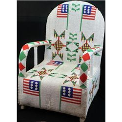 Fully beaded chair using white background in geometric patterns with American flag motif covering fr