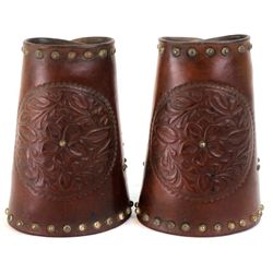 Pair floral carved and studded cowboy cuffs unmarked, classic styling and good condition with origin