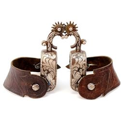 Pair of Vogt marked spurs with single mounted silver, and unmarked one piece straps. Spurs feature 1