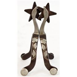 Pair unmarked McChesney goose neck spurs with vine and leaf pattern on outer heel bands, 5 point sta