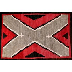 Early Navajo regional rug with brown border, red background, diagonal X pattern with stepped geometr