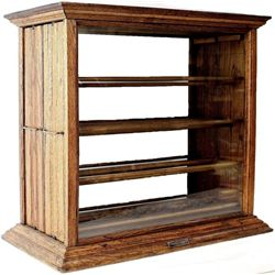 C. 1910 oak ribbon cabinet from early mercantile store with solid glass front and back, two pull out