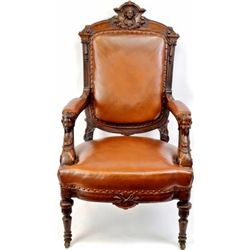 19th C. carved walnut arm chair in the style of master carver John Jellif, maidens on upper crest an