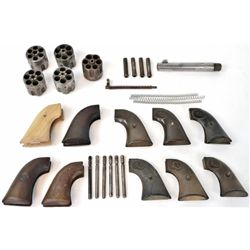 "Misc. Colt parts includes 10 pair of grips, 1 5 1/2"" .38 cal barrel, 5 cylinders including 2-.45 cal"