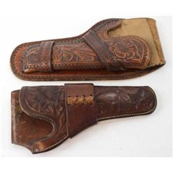 "Collection of 2 holsters includes HH Heiser floral carved single loop for Colt SA 5 1/2"" catalog 727"
