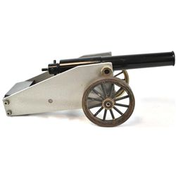 "Unmarked 16 ga. blank firing signal cannon with brass wheels, steel barrel and carriage, 16"" overall"
