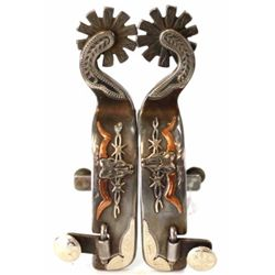 Pair of single mounted spurs with long horn design by Texas maker Wes Griffin and stamped Griff on h