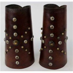 Good early pair spotted cowboy cuffs unmarked, border stamped design, leather soft and pliable with