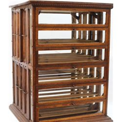 Terrific oak ribbon cabinet C. 1910 from early mercanitle store with 12 tip out glass front trays an