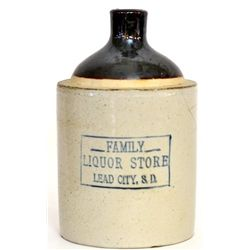 Antique advertising whiskey crock half gallon marked Family Liquor Store Lead City S.D. showing old