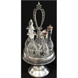 Victorian period 5 bottle cruet set with hand cut bottles in floral designs, silver plate base with