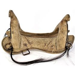 Rawhide wrapped Indian saddle with horse hair drops and made from old military saddle. Found in barn