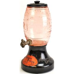 Original Mission Orange soda fountain dispenser with opaque black glass base, pink depression glass