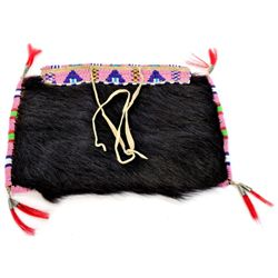 C. 1900's hair on leather beaded bag borders beaded in pinks, blues, white, green and red white hear