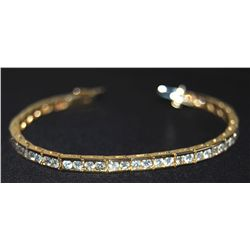 14k Yellow Gold channel set tennis bracelet.  Stam etc.
