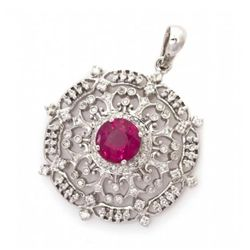 An 18 Karat White Gold Ruby and Diamond Pendant