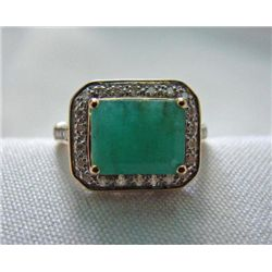 Ravishing 4.65 cts Emerald and .60cts Diamond ring in 1