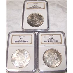 (3X$) NGC CERTIFIED MORGAN SILVER DOLLARS.