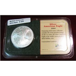 264. 2004 Silver American Eagle in Littleton Coin holder.