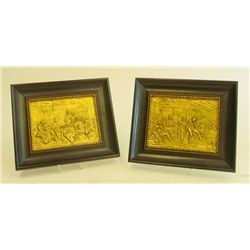 "Pair gilt metal ""Interior Scenes"" in black frame"