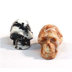 Two Carved Stone Skulls