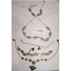 Three Necklaces as Shown.