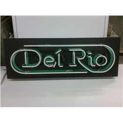 Del Rio Neon sign glows green