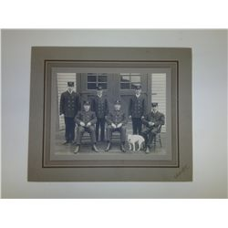Photo of 6 men in uniform with dog L 8in H 6in