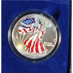 1999 AMERICAN SILVER EAGLE, COLORIZED ON THE FRONT, ONE OUNCE .999 SILVER