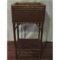 Wicker plant stand.