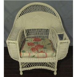 Large white wicker occasional chair.