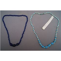 TWO STRANDS OF TRADE BEADS