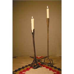 Antique wrought saddle iron candle stick holders