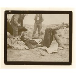 "L.A. Huffman, Cowboy laying on blanket, VCP on board in 100%  rag book mat, 4 5/8"" x 3 5/8"""