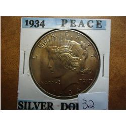 1934 PEACE SILVER DOLLAR (UNC) GOLDEN TONING