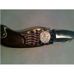 The American historical Society Collector Coin Knife has American flag motif