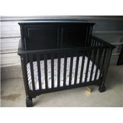 Dark wood baby crib 58w x 47t x 31d