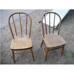 2 antique oak chairs .