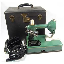 VINTAGE GENERAL ELECTRIC PORTABLE SEWING MACHINE IN CASE