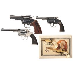 Three Colt Double Action Revolvers and Two Colt Derringers