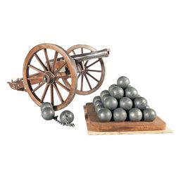 Miniature Cannon with Carriage with a Grouping of Cannonballs