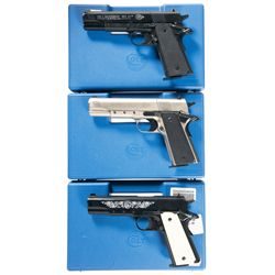 Three Colt Government Model 1911A1 Pellet Pistols with Original Hard Cases