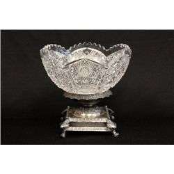 Cut glass bowl on plated stand