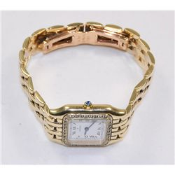 Ladies 14kt Movado watch with diamonds